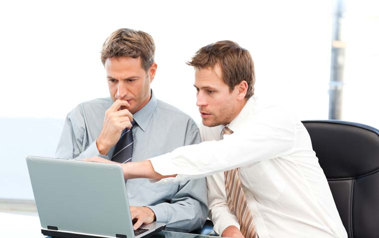 Two men working on a CV
