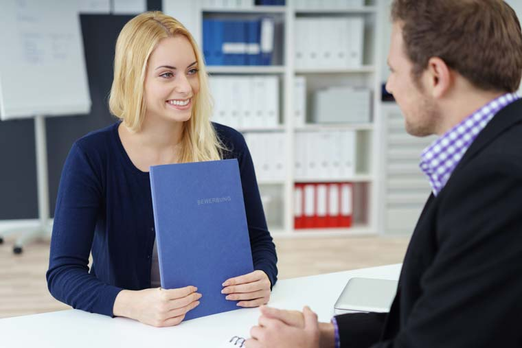 Man and woman in a job interview with a CV