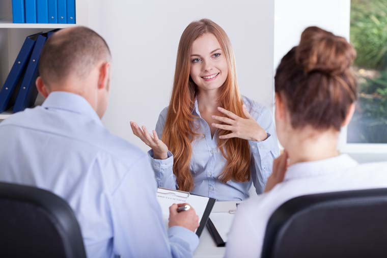 Woman in a job interview with two interviewers